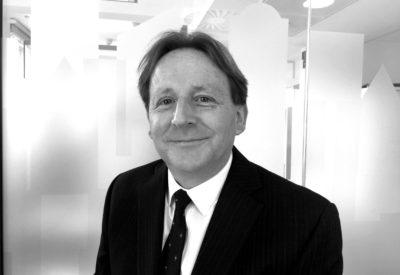 A headshot of Jeremy Aston.