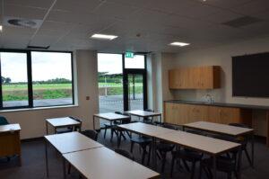 A classroom overlooking a field